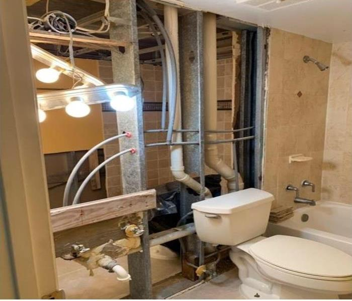 bathroom with no wall and steel rods and pipes